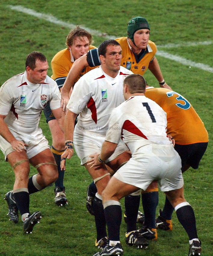 Photo: Steve Holland..Australia v England. Rugby World Cup Final, at the Telstra Stadium, Sydney. RWC 2003. 22/11/2003. .Martin Johnson prepares to to jumps against Justin Harrison.