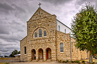 Our Lady of Perpetual Help, also known as St. Mary's Catholic Church was built in 1902 and is located atop St. Mary's Mountain in Altus, Arkansas. The church is on the National Register of Historic Places and has over five hundred members.<br /> <br /> The church is known for its Sistine Chapel-style paintings and grand Roman Basilical architecture. Brown stone blocks cover the outside of the church, and the inside walls are lined with ornate gold leaf. The organ inside the church is over 100 years old, as is the bell tower.