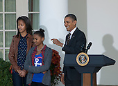United States President Barack Obama, right, and daughters Malia, left, and Sasha, center, participate in the annual White House ritual of granting a Presidential Pardon to the National Thanksgiving Turkey in the Rose Garden of the White House in Washington, D.C. on Wednesday, November 21, 2012.  This year's turkey, Cobbler, is 19-weeks old and weighs 40 pounds (18kg).  Cobbler, and his alternate, Gobbler, were named from submissions from elementary schools in Rockingham County, Virginia, where the turkeys were raised.  Following the pardoning ceremony, Cobbler and Gobbler will live out their lives at George Washington's Mount Vernon Estate and Gardens in Mount Vernon, Virginia.  .Credit: Ron Sachs / CNP
