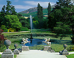 County Wicklow, Ireland<br /> Powerscourt Gardens from the Perron (the Italianate stairway) leading down to Triton Lake guarded by two statues of Pegasus with Sugar Loaf Mountain in distance
