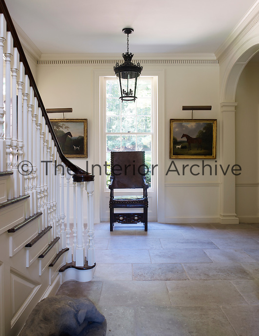 The stone-flagged hallway at the centre of the building has a classical simplicity