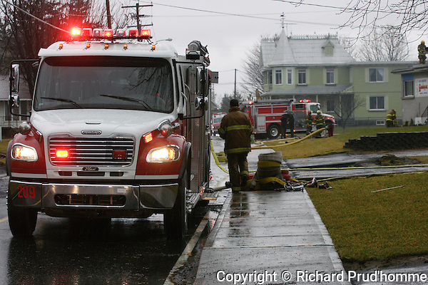 Fire truck on duty at the scene of a fire in Saint-Thomas-de-Joliette