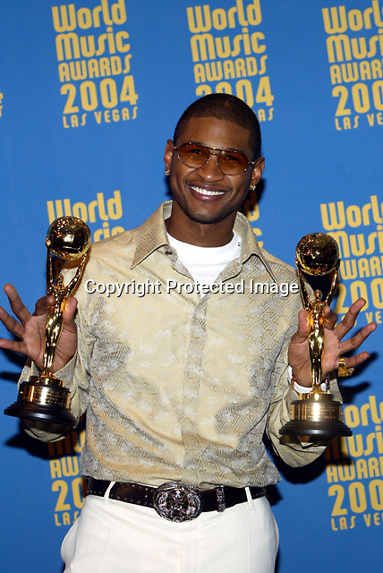 9/15/04,LAS VEGAS,NEVADA --- Usher shows two of the three awards that he won at the 2004 World Music Awards at the Thomas & Mack Center. Usher won for Best Male Artist, Best Pop Male Artist and Best R&B Artist. --- Chris Farina