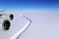 "Pictured: Aerial view of the rift in the Larsen C<br /> Re: Antarctic ice rift close to calving, after growing 17km in 6 days – latest data from ice shelf<br /> The rift in the Larsen C ice shelf in Antarctica has grown by 17km in the last few days and is now only 13km from the ice front, indicating that calving of an iceberg is probably very close, Swansea University researchers revealed after studying the latest satellite data.<br /> The rift in Larsen C is likely to lead to one of the largest icebergs ever recorded.  It is being monitored by researchers from the UK's Project Midas, led by Swansea University.<br /> Professor Adrian Luckman of Swansea University College of Science, head of Project Midas, described the latest findings:<br /> ""In the largest jump since January, the rift in the Larsen C Ice Shelf has grown an additional 17 km (11 miles) between May 25 and May 31 2017. This has moved the rift tip to within 13 km (8 miles) of breaking all the way through to the ice front, producing one of the largest ever recorded icebergs.<br /> The rift tip appears also to have turned significantly towards the ice front, indicating that the time of calving is probably very close.<br /> The rift has now fully breached the zone of soft 'suture' ice originating at the Cole Peninsula and there appears to be very little to prevent the iceberg from breaking away completely."""