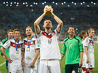 Per Mertesacker of Germany lifts the World Cup trophy after winning the 2014 final