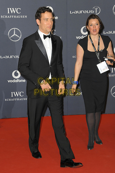 Clive Owen.Arrivals at the Laureus 2012 World Sports Awards held at the Queen Elizabeth II Centre, London, England..February 6th, 2012.full length black tuxedo.CAP/CAS.©Bob Cass/Capital Pictures.