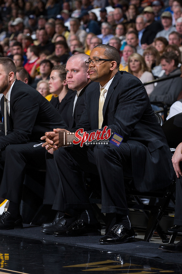 Wake Forest Demon Deacons assistant coach Steve Woodberry (right) watches from the bench during second half action against the Duke Blue Devils at the LJVM Coliseum on January 6, 2016 in Winston-Salem, North Carolina.  The Blue Devils defeated the Demon Deacons 91-75.  (Brian Westerholt/Sports On Film)