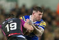 Picture by Allan McKenzie/SWpix.com - 08/02/2018 - Rugby League - Betfred Super League - Leeds Rhinos v Hull KR - Elland Road, Leeds, England - Leeds's Brett Delaney is tackled by Hull KR's Tommy Lee.