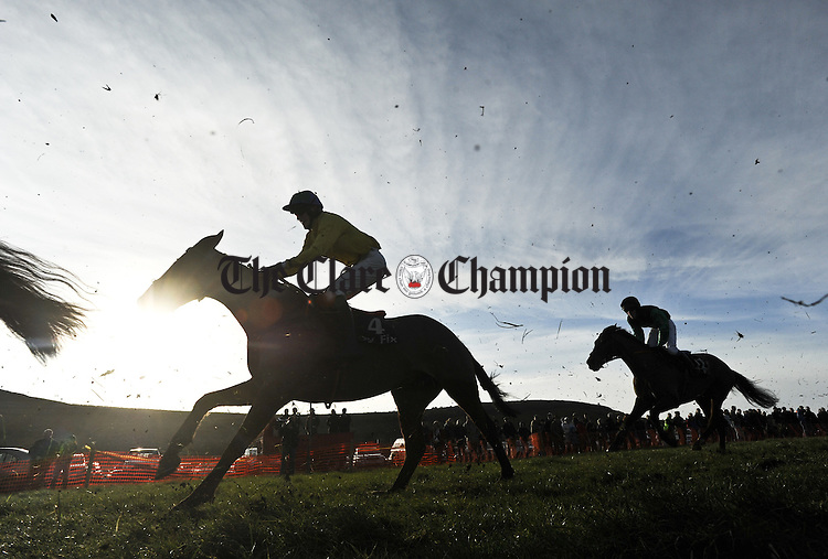 Horses and riders in action in the Spring sunshine at the Clare Hunt annual Point to Point at Bellharbour. Photograph by John Kelly.