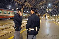 - police in security service in Milan Central Station....- polizia in servizio di sicurezza alla Stazione Centrale di Milano
