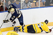 Nick Larson (Notre Dame - 26), Adam Ross (Merrimack - 26) - The University of Notre Dame Fighting Irish defeated the Merrimack College Warriors 4-3 in overtime in their NCAA Northeast Regional Semi-Final on Saturday, March 26, 2011, at Verizon Wireless Arena in Manchester, New Hampshire.