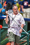 12 March 2014: Photographer Steve Moore moves to his shooting position prior to a Spring Training game between the Washington Nationals and the Houston Astros at Osceola County Stadium in Kissimmee, Florida. The Astros rallied in the bottom of the 9th to edge out the Nationals 10-9 in Grapefruit League play. Mandatory Credit: Ed Wolfstein Photo *** RAW (NEF) Image File Available ***
