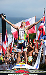 KAILUA-KONA, HI - OCTOBER 13:  Pete Jacobs of Australia crosses the finish line to win the 2012 IRONMAN World Championships on October 13, 2012 in Kailua-Kona, Hawaii. (Photo by Donald Miralle)