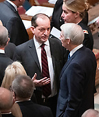 United States Secretary of Labor Alex Acosta, left, in conversation with US Senator Rob Portman (Republican of Ohio), right, prior to the start of the National funeral service in honor of the late former United States President George H.W. Bush at the Washington National Cathedral in Washington, DC on Wednesday, December 5, 2018.<br /> Credit: Ron Sachs / CNP<br /> (RESTRICTION: NO New York or New Jersey Newspapers or newspapers within a 75 mile radius of New York City)