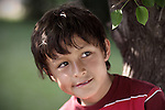 Boy looking from under tree - EXCLUSIVELY AVAILABLE HERE