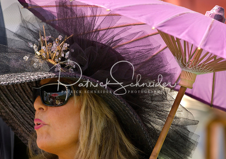 A woman shows off her themed hat during the Queen's Cup Steeplechase in Mineral Springs, NC.