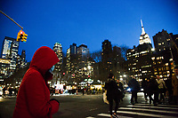 "NEW YORK, NEW YORK - MARCH 5: A woman wears a facial mask while crossing Bryant Park while viewing the Empire State Building on March 5, 2020. in New York City. New York State has 44 people in quarantine, some 4,000 people are in ""precautionary"" quarantine in more than two dozen counties, including more than 2,700 in the city and 1,000 in Westchester, Cuomo said. (Photo by Pablo Monsalve / VIEWpress via Getty Images)"
