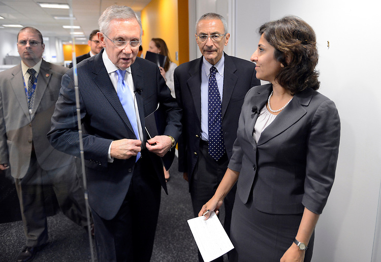 """UNITED STATES - JULY 15: Senate Majority Leader Harry Reid, D-Nev., left, John Podesta, chair of the Center for American Progress, and Neera Tanden, president, prepare for a discussion at CAP offices titled """"Ending Senate Gridlock."""" (Photo By Tom Williams/CQ Roll Call)"""