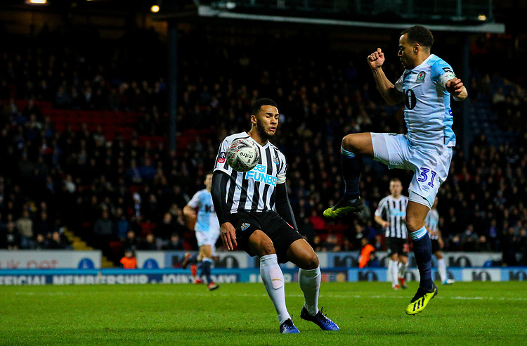Blackburn Rovers' Elliott Bennett vies for possession with Newcastle United's Jamaal Lascelles<br /> <br /> Photographer Alex Dodd/CameraSport<br /> <br /> Emirates FA Cup Third Round Replay - Blackburn Rovers v Newcastle United - Tuesday 15th January 2019 - Ewood Park - Blackburn<br />  <br /> World Copyright &copy; 2019 CameraSport. All rights reserved. 43 Linden Ave. Countesthorpe. Leicester. England. LE8 5PG - Tel: +44 (0) 116 277 4147 - admin@camerasport.com - www.camerasport.com