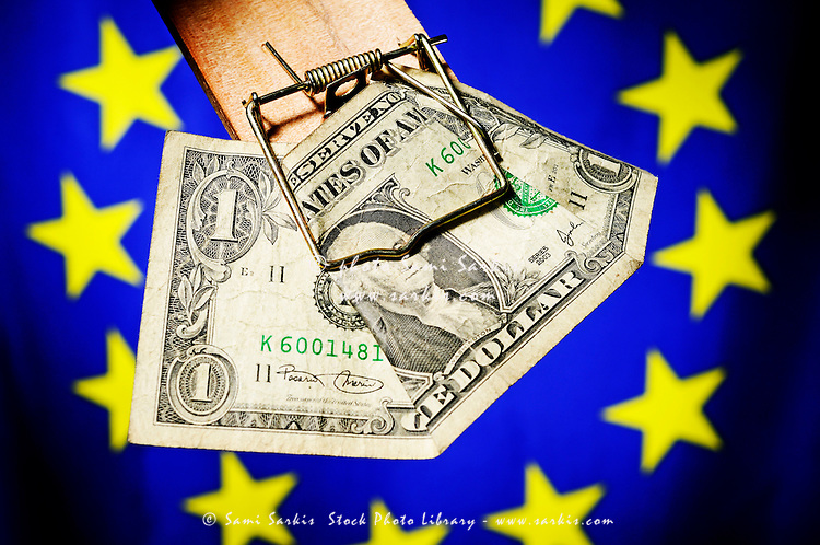 One dollar bill in mousetrap on European Union Flag