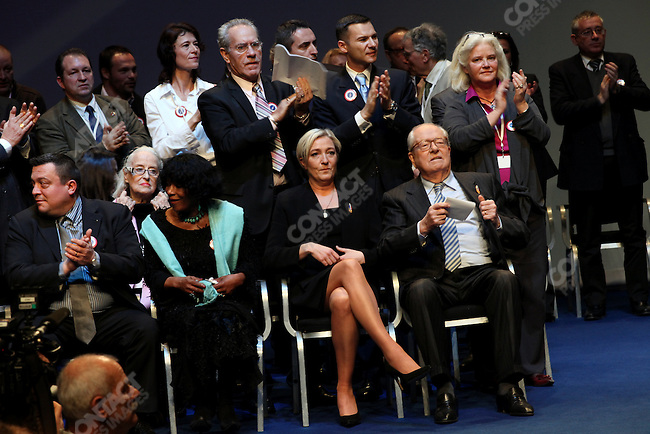 Marine Le Pen (center) succeeds her father Jean-Marie Le Pen (right) as president of the far-right National Front party, at their national congress, Tours, France, January 15-16, 2011