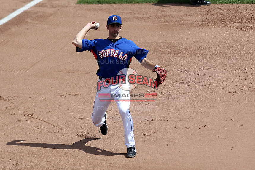Buffalo Bisons third baseman Josh Satin #2 throws to first during a game against the Toledo Mudhens at Coca-Cola Field on August 17, 2011 in Buffalo, New York.  Buffalo defeated Toledo 4-2.  (Mike Janes/Four Seam Images)