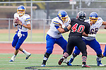Palos Verdes, CA 09/20/13 - Trey Tinsley (El Toro #15), Kyle Holman (El Toro #77), Zack Lopez (El Toro #65) and Roberto Ceja (Palos Verdes #40) in action during the El Toro versus Palos Verdes varsity football game at Palos Verdes High School.