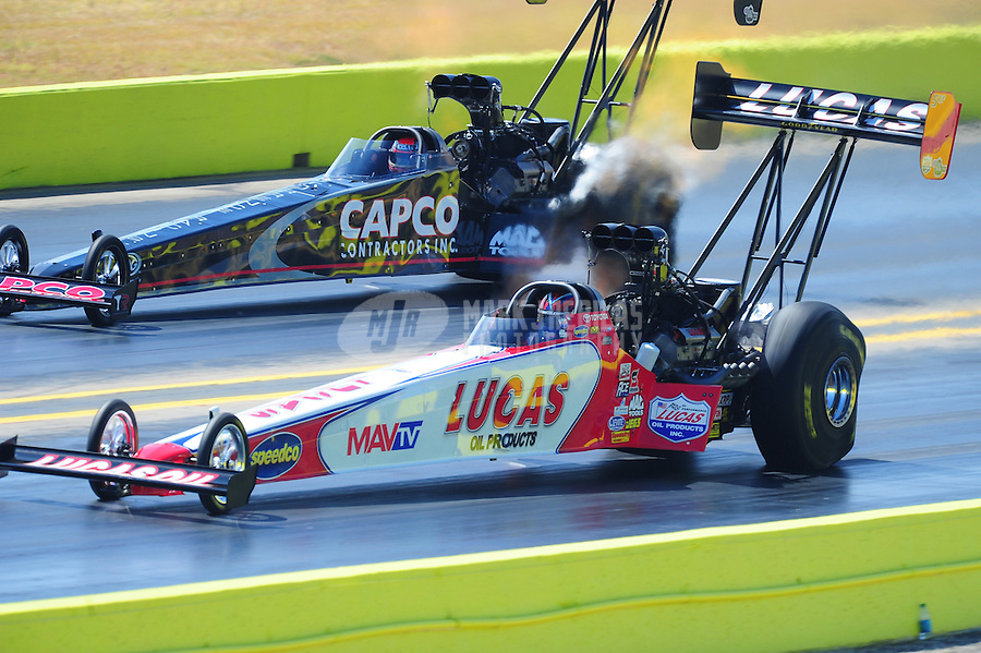 Sept. 24, 2011; Ennis, TX, USA: NHRA top fuel dragster driver Shawn Langdon (near lane) races alongside Steve Torrence during qualifying for the Fall Nationals at the Texas Motorplex. Mandatory Credit: Mark J. Rebilas-