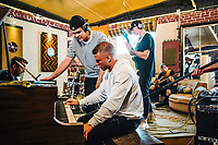 Carolina Panthers Running Back Christian McCaffrey plays piano as his friend Levi Waddell raps at The Decibel Garden in Denver, Colorado, Wednesday, June 26, 2019. <br />  <br /> Photo by Matt Nager