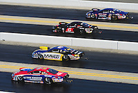 Apr. 13, 2012; Concord, NC, USA: NHRA pro stock drivers (from top) Kurt Johnson, Erica Enders, Rodger Brogdon and Shane Gray race downtrack during qualifying for the Four Wide Nationals at zMax Dragway. Mandatory Credit: Mark J. Rebilas-