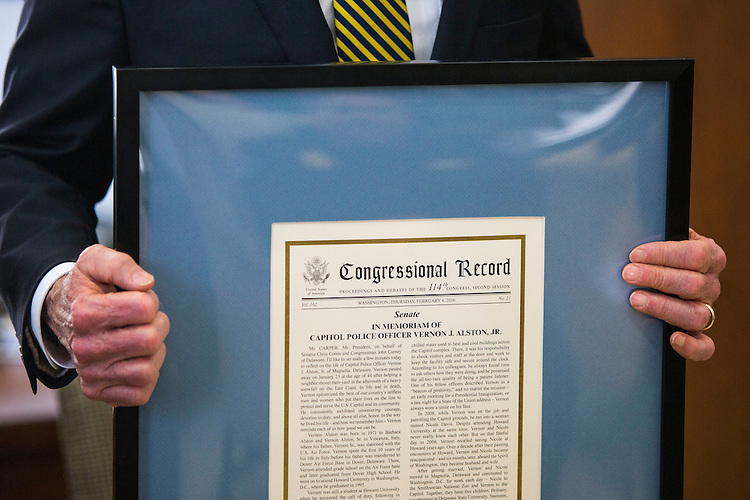 UNITED STATES - APRIL 14 - Sen. Tom Carper, D-Del., holds the Congressional Record signifying the memoriam of the late U.S. Capitol Police Offer Vernon Alston, on behalf of Delaware delegation, on Capitol Hill, in Washington, Thursday, April 14, 2016. (Photo By Al Drago/CQ Roll Call)