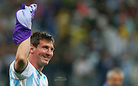Lionel Messi of Argentina celebrates winning the penalty shootout