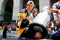 Evgeni Malkin #71 of the Pittsburgh Penguins holds the Stanley Cup during the victory parade in downtown Pittsburgh, Pennsylvania on June 15, 2016. (Photo by Jared Wickerham / DKPS)
