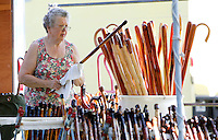 NWA Democrat-Gazette/DAVID GOTTSCHALK  Annabelle Taylor, of Siloam Springs, arranges walking sticks Friday, September 4, 2015 in her display area at the 64th annual Clothesline Fair at Fair at Prairie Grove Battlefield State Park. Taylor works with her husband James Taylor who is known as the Stick Man. The fair opens today and runs through Monday.