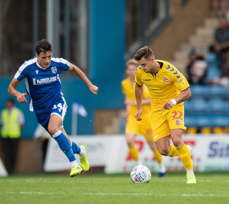 Bolton Wanderers' Dennis Politic (right) under pressure from Gillingham's Alfie Jones (left) <br /> <br /> Photographer David Horton/CameraSport<br /> <br /> The EFL Sky Bet League One - Gillingham v Bolton Wanderers - Saturday 31st August 2019 - Priestfield Stadium - Gillingham<br /> <br /> World Copyright © 2019 CameraSport. All rights reserved. 43 Linden Ave. Countesthorpe. Leicester. England. LE8 5PG - Tel: +44 (0) 116 277 4147 - admin@camerasport.com - www.camerasport.com