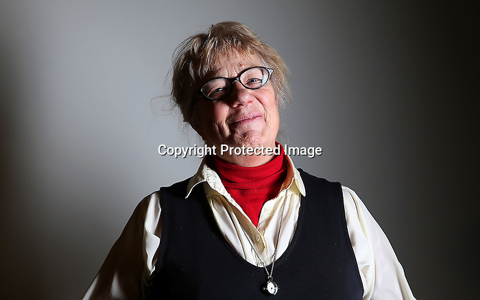 Margaret Shaw starts to laugh when asked to be serious during a portrait session at the Hynds building on New Year's Eve. Shaw is a retired teacher who taught at McCormick and Johnson Junior High Schools and thinks the people in Cheyenne are friendly and very welcoming. To participate in WTE Photo Editor Michael Smith's 2014 Our Faces: Portraits of Laramie County project, call to make an appointment at 633-3124 or 630-8388 or email msmith@wyomingnews.com. Michael Smith/staff