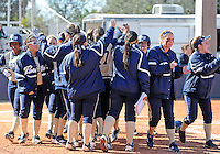 Florida International University team celebrates during the game against the University of Illinois.  FIU won the game 8-0 on February 12, 2012 at Miami, Florida. .