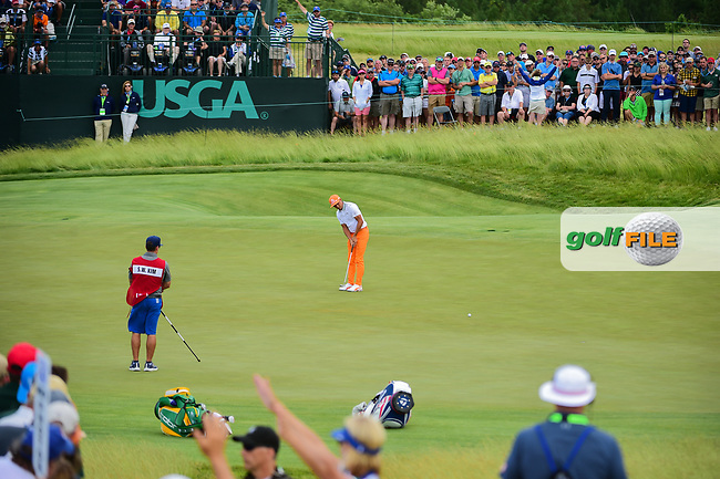 Rickie Fowler (USA) watches his putt on 7 during Sunday's round 4 of the 117th U.S. Open, at Erin Hills, Erin, Wisconsin. 6/18/2017.<br /> Picture: Golffile | Ken Murray<br /> <br /> <br /> All photo usage must carry mandatory copyright credit (&copy; Golffile | Ken Murray)