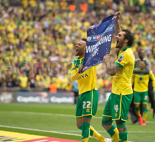25.05.2015.  London, England. Skybet Championship Playoff Final. Middlesborough versus Norwich. Norwich City's Nathan Redmond and Bradley Johnson celebrate at the final whistle as they get promoted to the Premiership.