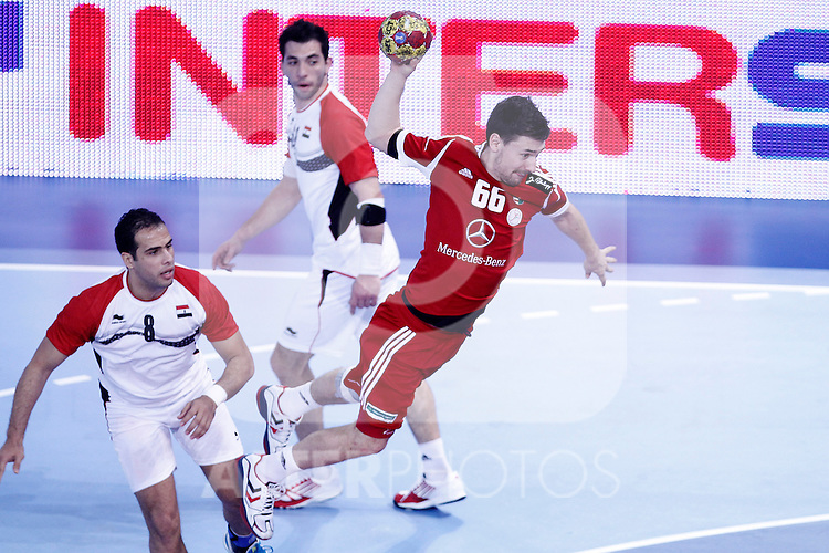 Hungary's Mate Lekai (r) and Egypt's Mohamed Ahmed during 23rd Men's Handball World Championship preliminary round match.January 12 ,2013. (ALTERPHOTOS/Acero)