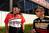 Nov 14, 2010; Pomona, CA, USA; NHRA top fuel dragster driver Dom Lagana (left) talks with Tony Schumacher during the Auto Club Finals at Auto Club Raceway at Pomona. Mandatory Credit: Mark J. Rebilas-