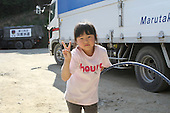 May 18, 2011; Minamisanriku, Miyagi Pref., Japan - Ruka Sato, 5 poses with a hula hoop at the Shizukawa High School Evacuation Center in Minamisanriku after the magnitude 9.0 Great East Japan Earthquake and Tsunami that devastated the Tohoku region of Japan on March 11, 2011.