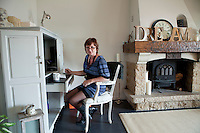 Nicole Bekdache works on her blog at the desk in her lounge, near Grasse, France, 30 March 2012.