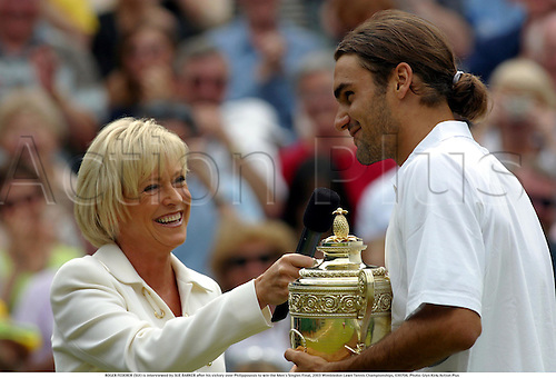 ROGER FEDERER (SUI) is interviewed by SUE BARKER after his victory over Philippoussis to win the Men's Singles Final, 2003 Wimbledon Lawn Tennis Championships, 030706. Photo: Glyn Kirk/Action Plus...2003 player players men man.winner wins win winning.interview interviews trophy trophies