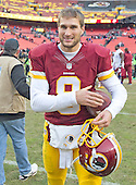 Washington Redskins quarterback Kirk Cousins (8) smiles as he leaves the field after leading his team to a 35-25 victory over the Buffalo Bills at FedEx Field in Landover, Maryland on Sunday, December 20, 2015.  <br /> Credit: Ron Sachs / CNP