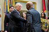 U.S. President Donald Trump shakes hands with Marvin Ellison, chairman and chief executive officer of J.C. Penny Co. Inc., during a listening session with the Retail Industry Leaders Association and member company chief executive officers in the Roosevelt Room of the White House in Washington, D.C., U.S., on Wednesday, Feb. 15, 2017. Questions about ties between Trump's team and Russian intelligence agents mounted Wednesday after new reports of extensive contacts between the two, which are sure to fuel Republican calls for a deeper look at Trump's links to the country. <br /> Credit: Andrew Harrer / Pool via CNP