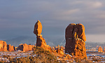 A winter sunset lights up Balanced Rock at Arches National Park, near Moab, Utah.