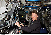 In Earth Orbit - July 12, 2006 -- Astronaut Lisa M. Nowak, STS-121 mission specialist, works with the Mobile Service System (MSS) and Canadarm2 controls in the Destiny laboratory of the International Space Station while Space Shuttle Discovery was docked to the station..Credit: NASA via CNP