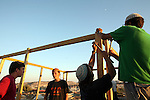 Jewish boys participate in the building of new structures at the Mitzpe Avichai outpost near the west bank city of Hebron, Tuesday evening July 28, 2009. Mitzpe Avichai is one of the 11 newly-built illegal outposts that were established earlier in the week by the settlers as a response to USA pressure on Israel to freeze construction in the West Bank. Israeli security forces demolished the Mitzpe Avichai outpost late Tuesday night, but the activists have vowed to rebuild it. Photo By: Tess Sheflan / JINI.