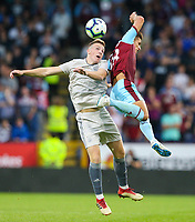 Burnley's Ashley Westwood battles with Aberdeen's Lewis Ferguson<br /> <br /> Photographer Alex Dodd/CameraSport<br /> <br /> UEFA Europa League - Europa League Qualifying Round 2 2nd Leg - Burnley v Aberdeen - Thursday 2nd August 2018 - Turf Moor - Burnley<br />  <br /> World Copyright © 2018 CameraSport. All rights reserved. 43 Linden Ave. Countesthorpe. Leicester. England. LE8 5PG - Tel: +44 (0) 116 277 4147 - admin@camerasport.com - www.camerasport.com